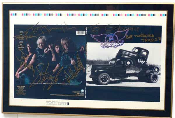 aerosmith  u2013 signed  laminated pump album cover proof